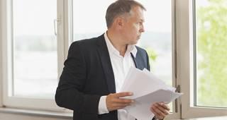 Private Krankenversicherung für Selbstständige: Mann im Büro